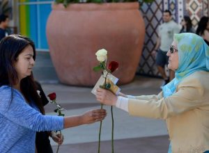 Fatemeh Nassirian, president of the Muslim Women Network of Southern California,  hands  out a free rose at the Irvine Spectrum on Saturday.  ///ADDITIONAL INFORMATION: muslimroses.0412 Ð 4/11/15 Ð BILL ALKOFER, - ORANGE COUNTY REGISTER -   The Muslim Women Network of Southern California handed out more than 500 free roses at the Irvine Spectrum Carousel Court on Saturday. The event was held to counter misconceptions about Islam.  Each rose had a card attached with a quote from the Prophet Muhammad:
