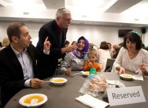 Inker Yildiz, left, Steve Sherman, Emine Yildiz, Kerem Akif Yidiz and Rabbi Heidi M. Cohen join together to break a fast at Temple Beth Sholom in Santa Ana on Friday. A celebration of interfaith, jews and muslims sat down during Ramadan on Shabbat to get to know one another and eat lentil soup, potatoes, chicken and dessert.   ///ADDITIONAL INFORMATION :7/1/16  interfaithramadan.0703.mm - MATT MASIN, STAFF PHOTOGRAPHER
